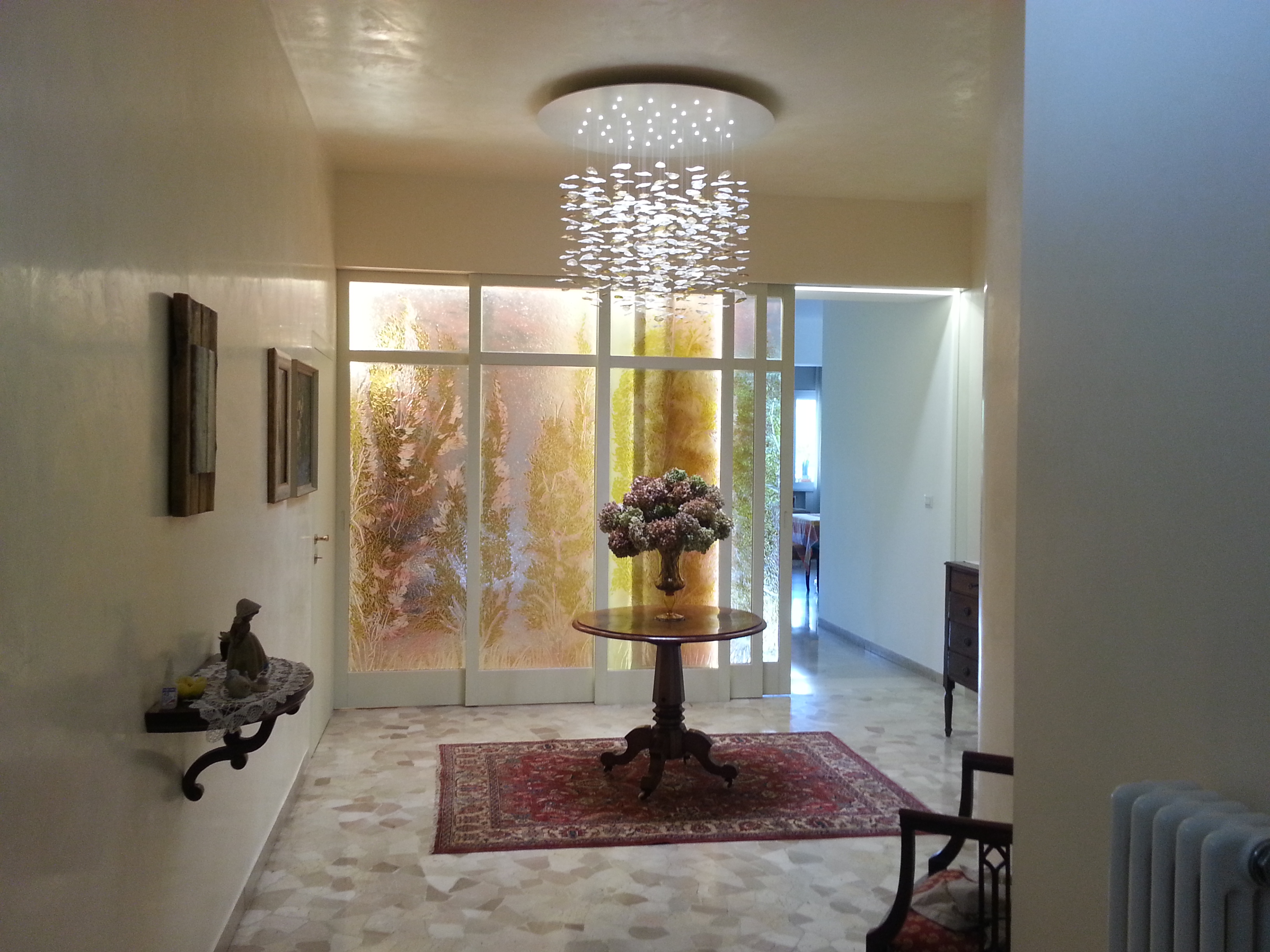 glass chandelier and glass doors