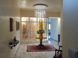 glass chandelier and glass doors