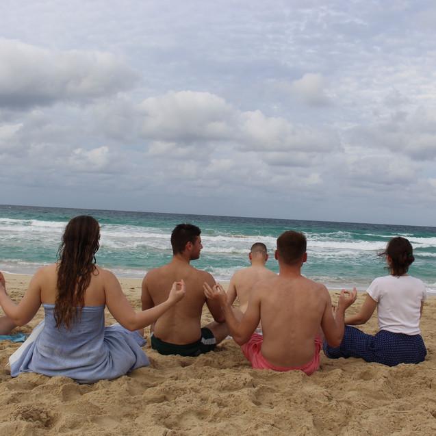 Meditating in the beach