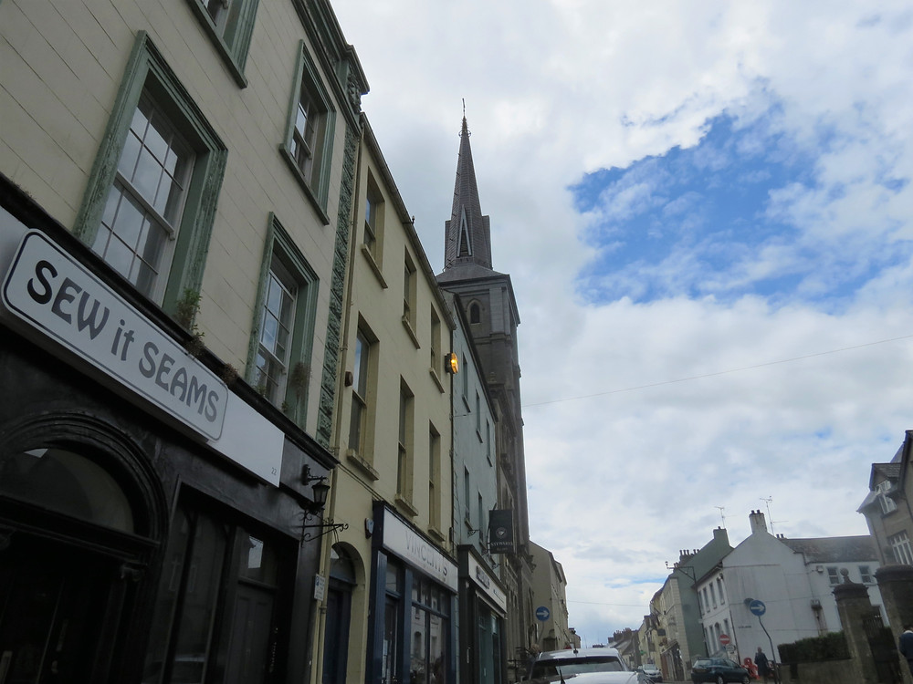 Enniskillen Town Centre, showing store facades and a church