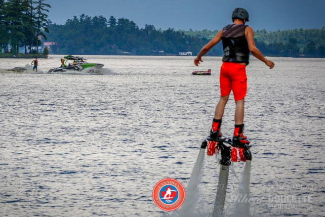 Flyboard infront of some wakeboarders at the 2014 Wake Surf Nationals.