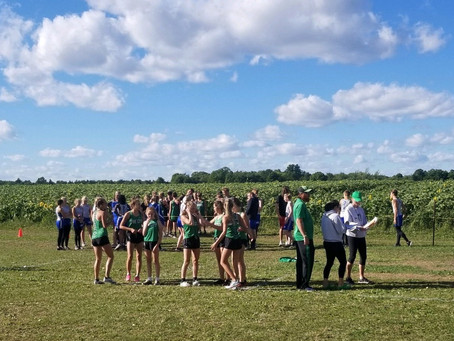 Eva Johnson and Charlie Ausmus Win First Cross Country Meet