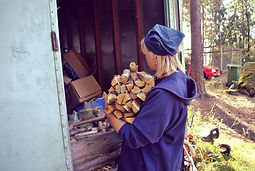 Lillemor Chopping Wood  for Tunnbröd Recipe in Böllnas, Sweden