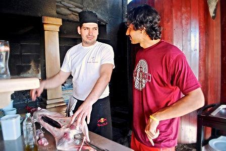 Chef Ivan showing Anthony how to put a lamb on a spit at Konoba Kopačina, Donji Humac, Brač, Croatia