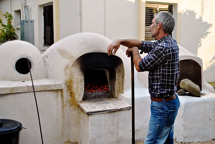 Kamel watching the Fire in the clay oven, Cyprus