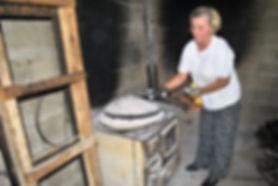 Maritza Preparing the Peka, Imotski, Croatia