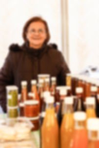 Jamileh's standing behind her preserves at the souk el tayeb market in downtown Beirut, Lebanon