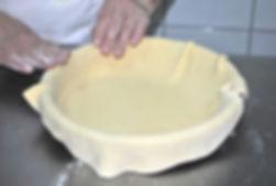 Spreading pie dough over pie dish, Ana's Imotska Torta Recipe
