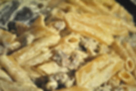 Adding the Penne to the sausage cream sauce - Penne alla Norcina Recipe