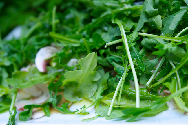 Fresh Arugula over the sliced white mushroom caps, White Mushroom Arugula Salad Recipe