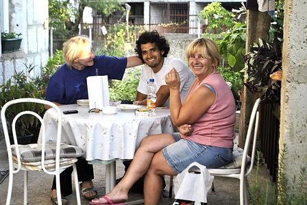 Maritza, Anthony, and Marija sitting down after Calling Ane, Imotski, Croatia