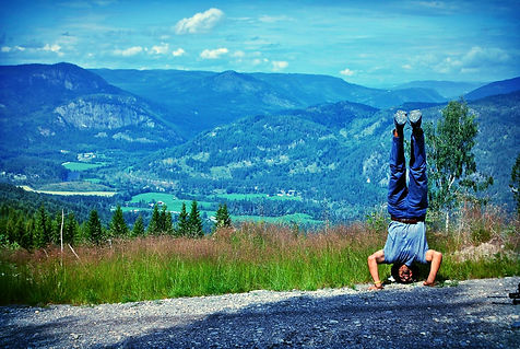 Anthony From The Recipe Hunters doing a handstand at the top of a mountain in Norway