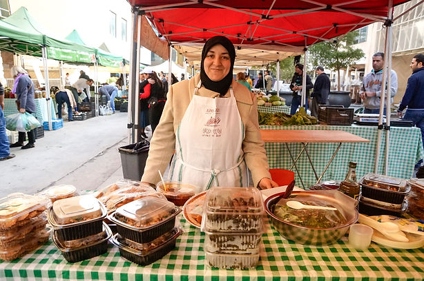 Imane at Souk El Tayeb selling traditional syrian homemade food in Beirut, Lebanon