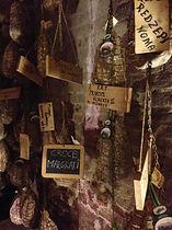 Hanging Prosciutto in the Basement of Antica Corte Pallavicina, Italy