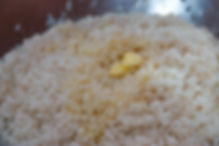 Adding butter to the rice, Fwereh Lebanese Sausage Recipe