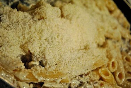Adding Parmigiano Reggiano to the Penne alla Norcina Recipe