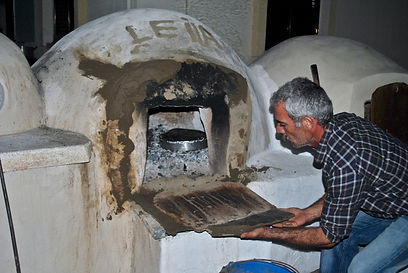 Kamel Removing the door from the hot clay oven, Cyprus