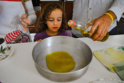 layla watching the olive oil fall to the pan