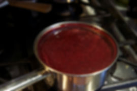 Removing the pudding from the heat,  Sugoli con Mosto D'Uva Recipe aka Grape Must Pudding