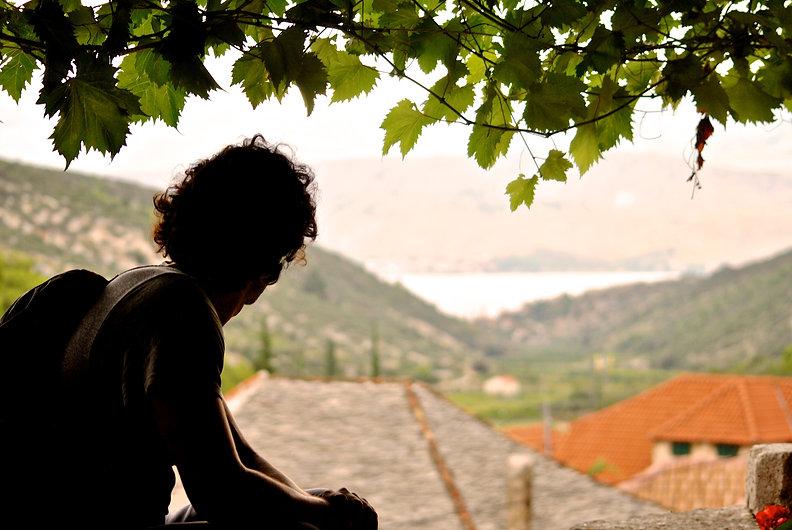 Anthony Overlooking View of Mediterranean Ocean, Dol, Brač, Croatia