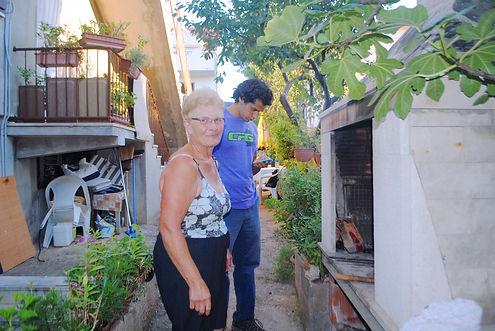 Domina teaching Anthony how to Grill Fish in Supetar, Brač, Croatia