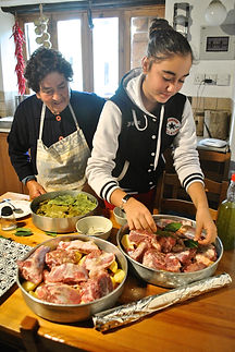 Diren Helping Grandmother Make Firin Kebab, Traditional Cypriot Dish