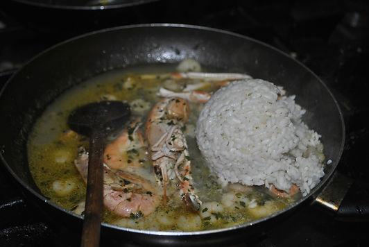 Adding rice to Ante's White Scampi Risotto Recipe, Konoba Lukin, Brač, Croatia