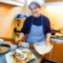 Nada Saber presenting her fattet batenjain, eggplant yogurt lebanese recipe, the recipe hunters in lebanon