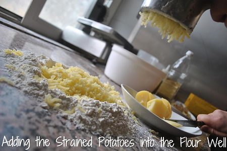 Adding Strained Boiled Potatoes to the Mound of Flour - Mamma Angela's Homemade Gnocchi Recipe