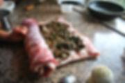 Adding Salt while rolling the pancetta - Porchetta Ripiena aka Stuffed Pork Recipe