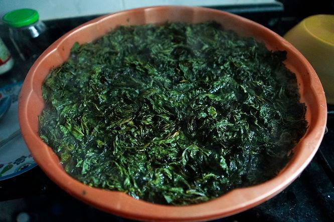 molokhia leaves soaking in hot water, lebanese recipes