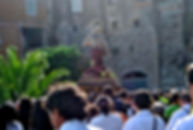 Statue of Jesus Christ being carried through a procession of people, Saint Hilarion Day, Caulonia, Italy