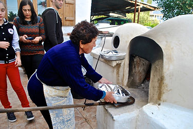 Aysan putting Firin Kebab into the Clay Oven, Cyprus