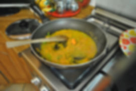 Frying the grated vegetable in olive oil - Sausage and Lentils Recipe