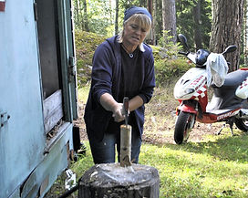 Lillemor chopping wood for the Tunnbröd Recipe, Böllnas, Sweden