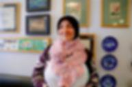 Imane wearing her crochet scarf at Tawlet in Beirut, Lebanon