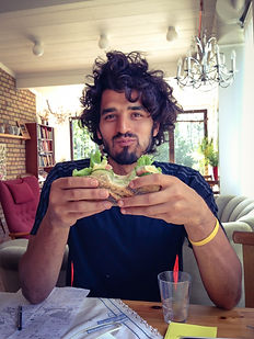 Anthony Morano eating a ham sandwich at Berglunds Bakery in Küngsgarden, Sweden