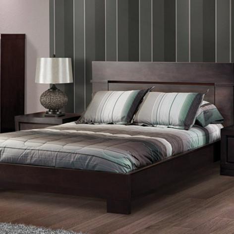 Bedding with dark wood dresser, bed fram