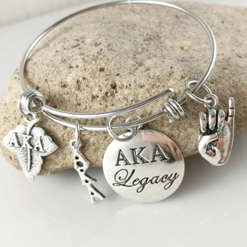 Silver bracelet and charms.