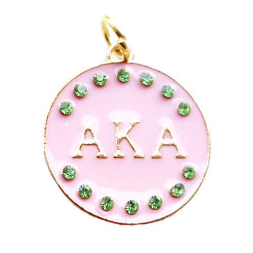 green crystals, center light, a pink marblieized filling and AKA letters in gold .
