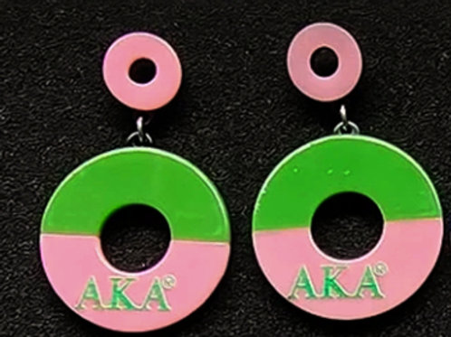 Half green, half pink with AKA in pink, pink colored attacher.