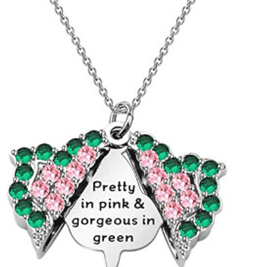 Green crystals outline the inner pink crystals. Silver inner ivy. Silver chain.