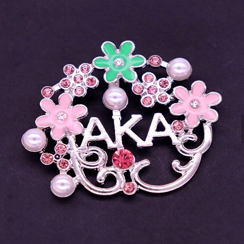 Pink, green flowers. White pearls. Silver AKA.