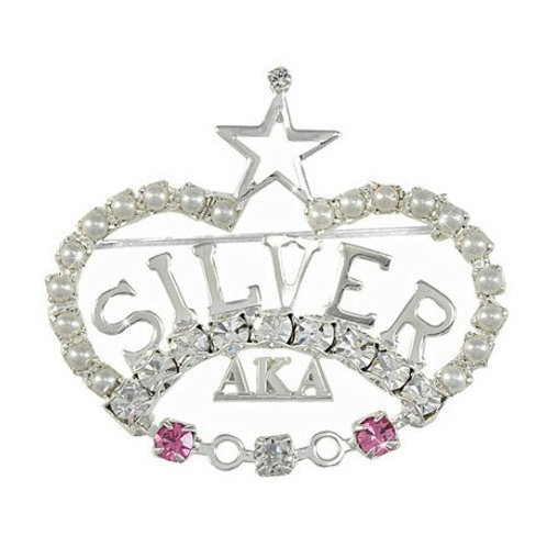 Crown is clear crystals. AKA in silver. 2 pink crystals in the bottom of the crown outline.