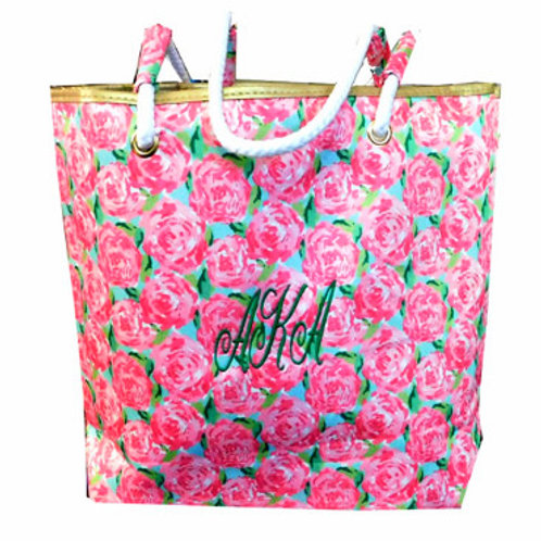 Front View. Pink roses scattered on green background. Green AKA. White handles.
