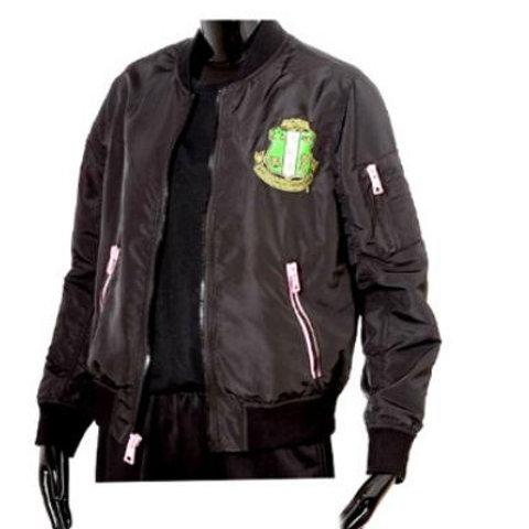 Black jacket, green gold shield, pink zipper on two front pockets and shoulder pocket.