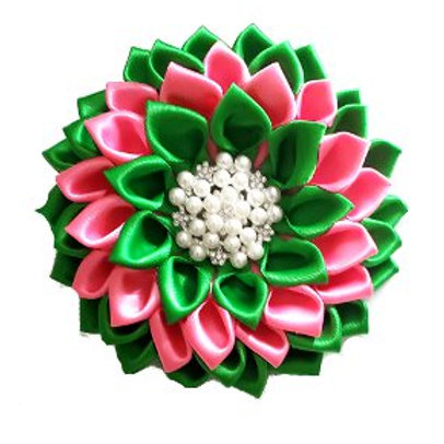 Pink, green petals. Center is white pearls, clear crystals.