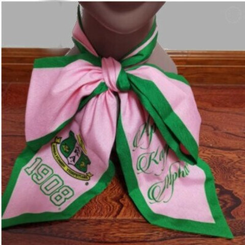 Pink with green border and printing.