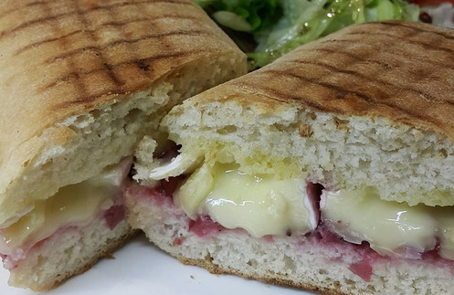 Brie & cranberry panini, salad, crisps
