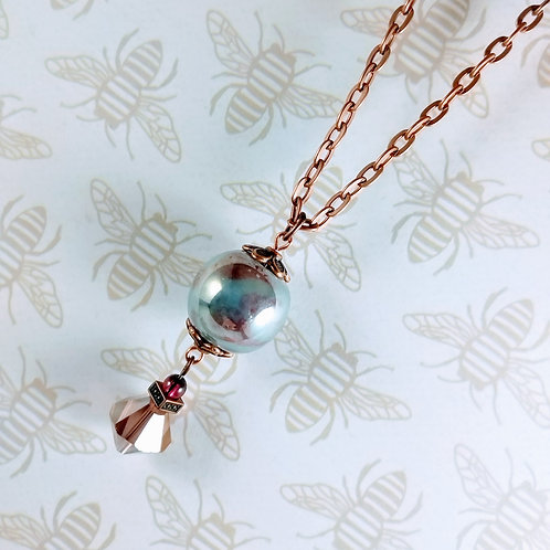 Gray Orb Crystal Copper Necklace With Garnet